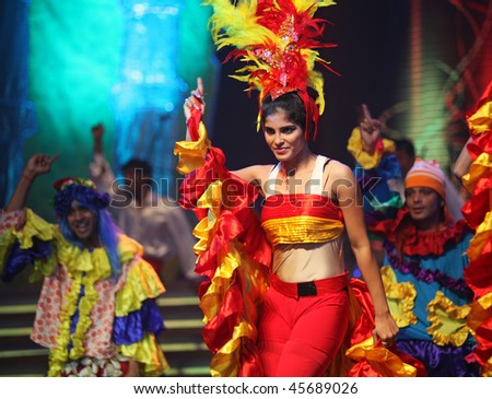 BEIJING - JANUARY 31: Dancers wearing colored outfit perform on stage during Indian Music and Dance Show at Beijing Exhibition Theater on January 31, 2010 in Beijing, China. - stock photo