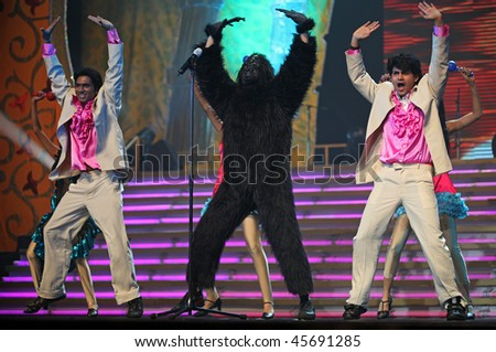 BEIJING - JANUARY 31: The Indian Bollywood Film Star Song and Dance Troupe perform on stage during Indian Music and Dance Show at Beijing Exhibition Theater on January 31, 2010 in Beijing, China. - stock photo