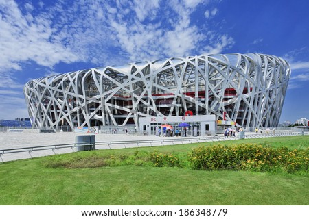 BEIJING-JULY 28, 2013. Bird's Nest on a summer day. The Bird's Nest is the Olympic stadium in Beijing, China, especially designed for use throughout the 2008 Summer Olympics and Paralympics. - stock photo