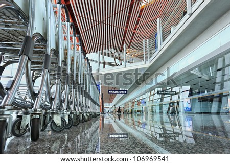 BEIJING JULY 6, 2012. Capital Airport Terminal 3 on July 6, 2012 in Beijing. The airport has registered 488,495 annually aircraft movements (take-offs and landings) and ranked 10th in the world. - stock photo