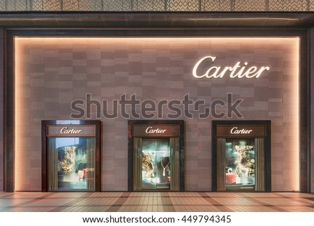 BEIJING-JULY 6, 2016. Cartier outlet exterior at night. Luxury retailers like Cartier whose sales are hit by China's economy slowdown, pushing marketing campaigns on social-media like Weibo and Wechat - stock photo