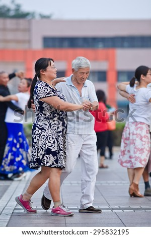 BEIJING-JULY 10, 2015. Collective square dancing. Its vast popularity has also a drawback, due to the nuisance the Chinese government will launch soon national standards and regulations to guide it.