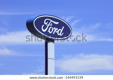 BEIJING-JULY 3. Ford signage. Founded by Henry Ford, June 16, 1903, Ford is the second largest U.S. based automaker, fifth-largest in the world based on 2010 vehicle sales. Beijing, July 3, 2013. - stock photo
