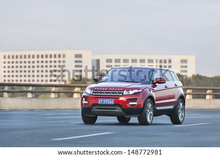 BEIJING-JULY 5. Range Rover Evoque on the road. Global and upcoming Chinese automakers are scrambling to cash in on the explosive popularity of sport utility vehicles in China. Beijing, July 5, 2013. - stock photo