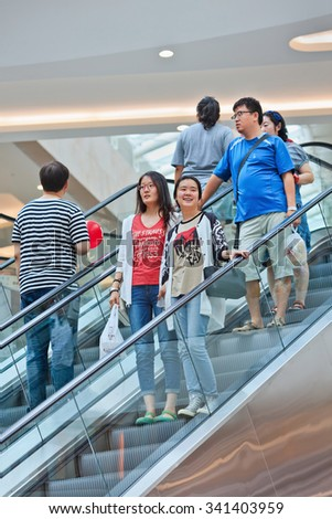 BEIJING-JULY 18, 2015. Shoppers at Livat shopping mall. Owned by Inter Ikea Centre Group, Livat has more than 400 renowned domestic and international brands like H&M, Zara, Forever 21 and Old Navy.  - stock photo