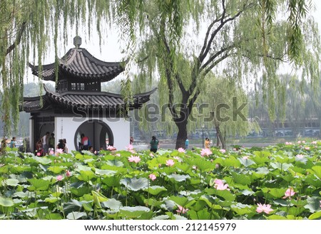 BEIJING - JULY 26, 2014 : Taoranting park on July 26, 2014 in Beijing, China. Famous for its pavilions and lotus field, the park is a popular tourist attraction in summer.   - stock photo