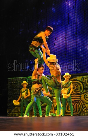 BEIJING - JUNE 5: Beijing Acrobatics Troupe artists perform at the famous Chaoyang Theatre on June 5, 2011, in Beijing, China. - stock photo