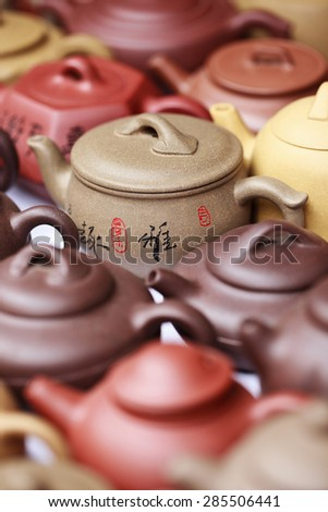 BEIJING-JUNE 7, 2015. Chinese earthenware on Panjiayuan Market, located in south east Beijing. It covers 48,500 sq. meters, of which 26,000 sq. meters business, over 4,000 shops and 10,000 dealers. - stock photo