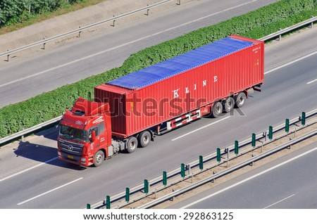 BEIJING-JUNE 30, 2015. Chinese truck with K Line container. Kawasaki Kisen Kaisha, branded as K Line, is one of the largest Japanese transportation companies with many container ships and terminals. - stock photo