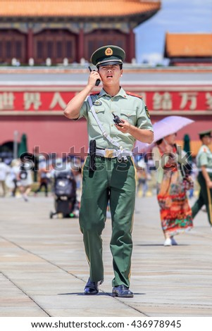 BEIJING-JUNE 11, 2016. Honor guard on Tiananmen Square. Honor guards are provided by the People's Liberation Army at Tiananmen Square for flag-raising ceremony and presence on the famous city Square. - stock photo