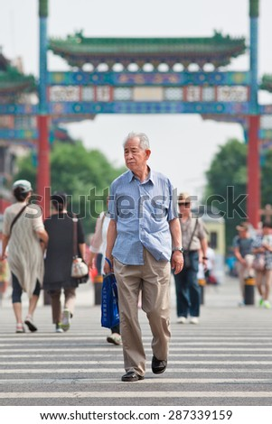 BEIJING-JUNE 9, 2015. Old Chinese man. The elderly population (60 or older) in China is about 128 million, one in every ten people, the world's largest. China will have 400 million elderly by 2050. - stock photo