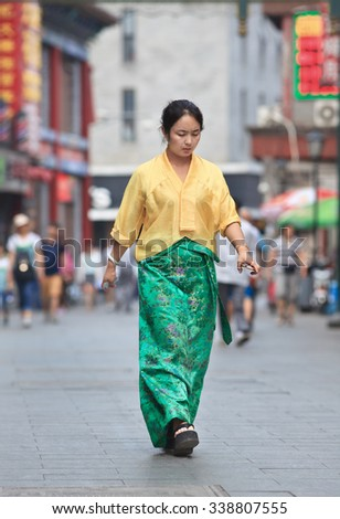 BEIJING-JUNE 9, 2015. Traditional dressed woman. Lives of Chinese women have significantly changed since rise of the People's Republic of China, which publicly committed itself to gender equality.  - stock photo
