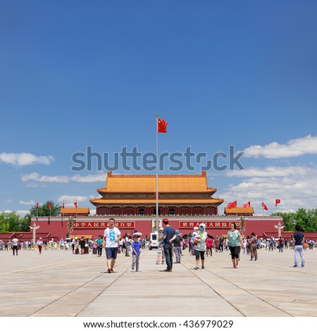 BEIJING-JUNE 11, 2016. Visitors on sunny Tiananmen Square. With 440,500 m2 it is one of the world's largest squares and has great cultural significance as place of important events in Chinese history. - stock photo