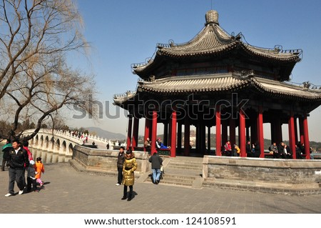 BEIJING - MAR 14:Visitors the Summer Palace in Beijing China on March 14 2009. The Summer Palace is the best preserved imperial garden in the world. - stock photo