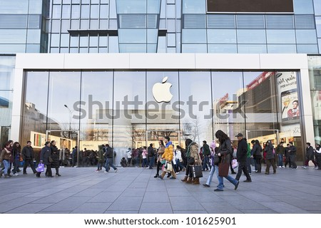 BEIJING- MARCH 10, 2012. Apple store on March 10, 2012 in Beijing. In 2011, Apple sold 172 million iPods, iPhones and iPads, These post-PC devices making up a total of 76-percent of Apple's revenue. - stock photo