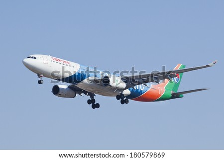 BEIJING-??MARCH 6, 2014. China Eastern Airbus A330-300, B-6100. Wide-body twin-engine jet airliner,  range of 7,400 to 13,430 kilometers and can accommodate up to 335 passengers in a two-class layout. - stock photo