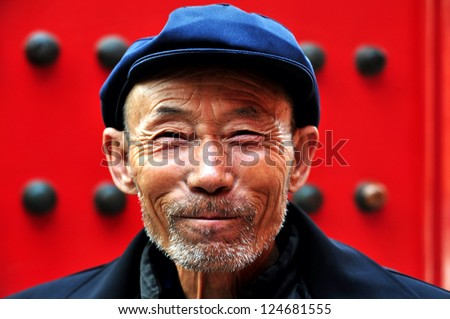 BEIJING - MARCH 11:Chinese man at the Forbidden City on March 11 2009 in Beijing,China. The average life expectancy among Chinese men is 72 years - stock photo