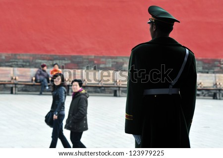 BEIJING - MARCH 11:Chinese soldier guards inside the Forbidden City on March 11 2009 in Beijing,China.Military service in China is compulsory, in theory, for all men who attain the age of 18 - stock photo