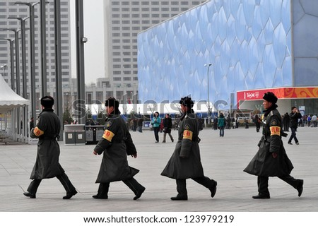 BEIJING - MARCH 14:Chinese soldiers guards Beijing National Aquatics Center on March 14 2009 in Beijing,China.It hosted the swimming, diving and synchronized swimming events of  2008 Summer Olympics - stock photo