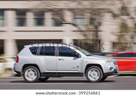 BEIJING-MARCH 30, 2016. Jeep Compass on the road. American brand Chrysler planned to increase its Jeep dealerships in China by about a third and will start local production of Cherokee SUV in 2016. - stock photo
