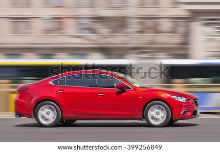 BEIJING-MARCH 30, 2016. Red Mazda 6 sedan. Mazda its sales in China delivered a meager rise of 1.2% year on year to 15,983 units. Mazda models 3, 6 and CX-5 were the three best sellers in China.