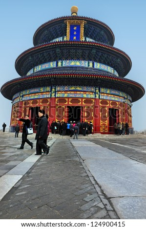 BEIJING - MARCH 15: Visitors at the Temple of Heaven on Mar 15 2009 in Beijing, China. The Temple of Heaven is regarded as one of the Beijing's Top 10 tourist attractions. - stock photo