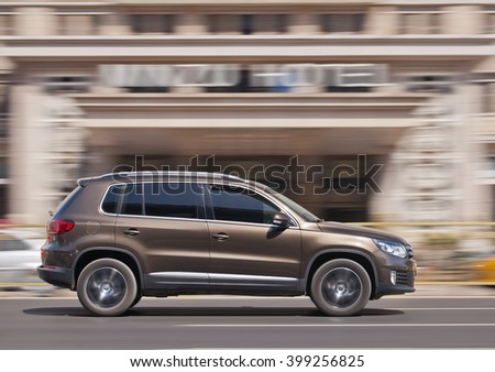 BEIJING-MARCH 30, 2016. Volkswagen Tiguan SUV. China is the place where VW CEO Matthias Mueller can enjoy a brief respite from its emissions scandal: The country is the automaker's biggest market.  - stock photo