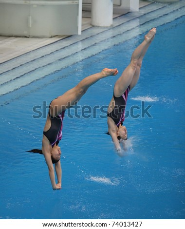 BEIJING - MARCH 25: Wu Minxia and He Zi of China warm up before the start of the Women's 3m Springboard Synchro Final of the FINA/Midea Diving World Series 2011 on March 25, 2011 in Beijing, China.