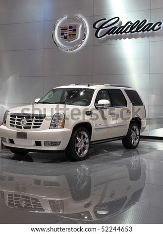 BEIJING - MAY 2: A Cadillac Escalade Hybrid SUV is on display at the 2010 Beijing International Automotive Exhibition (Auto China 2010) on May 2, 2010 in Beijing, China. - stock photo