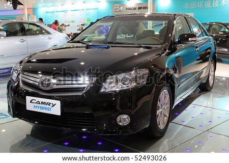 BEIJING - MAY 2: A Toyota Camry Hybrid is on display at the 2010 Beijing International Automotive Exhibition (Auto China 2010) on May 2, 2010 in Beijing, China. - stock photo