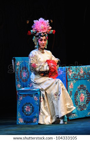 """BEIJING - MAY 28: Actress of the Beijing Opera Troupe performs the famous story """"Husband and Wife"""" at the Liyuan Theatre on May 28, 2012, in Beijing, China. - stock photo"""