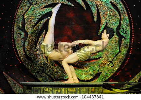 BEIJING - MAY 6: Beijing Acrobatics Troupe artists perform at the famous Chaoyang Theatre on May 6, 2012, in Beijing, China. - stock photo