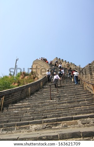 Beijing  - May 10: Tourists sightsee in the Great Wall of China - May 10,2012 in Beijing China. The emergence of a newly rich middle class is fuelling this travel boom.  - stock photo