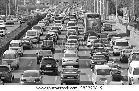 BEIJING - MAY 11: Traffic jam in Beijing's Central Business District on May 11, 2014 in Beijing, China. Beijing is expected to pass the six million vehicles on its roads by the end of the year. - stock photo