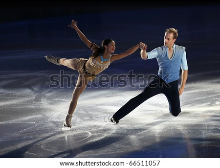BEIJING-NOV 7: Amanda Evora and Mark Ladwig of USA perform in the Gala Exhibition event of the SAMSUNG Cup of China ISU Grand Prix of Figure Skating 2010 on Nov 7, 2010 in Beijing, China. - stock photo