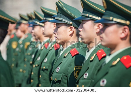 BEIJING - NOV 8: Chinese soldiers attend a parade at Tiananmen square on November 8, 2012 in Beijing, China. The Chinese army is the largest in the world, with a strength of around 2,285,000 soldiers. - stock photo