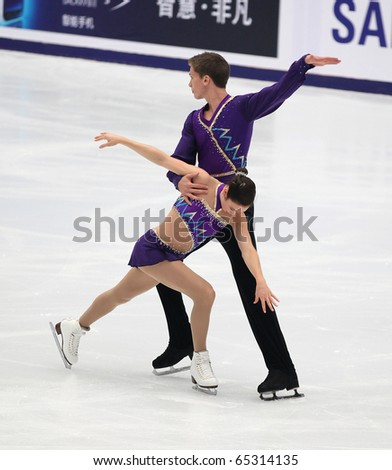 BEIJING - NOV 6: Kaleigh Hole / Adam Johnson of Canada perform in the Pairs-Free Skating event of the SAMSUNG Cup of China ISU Grand Prix of Figure Skating 2010 on Nov 6, 2010 in Beijing, China. - stock photo