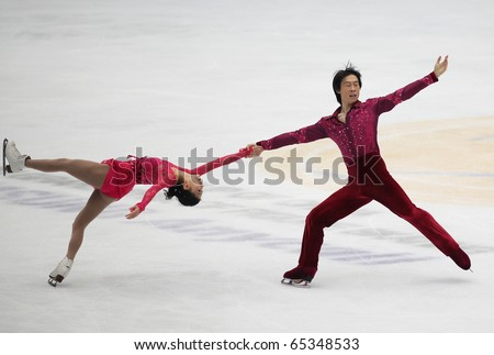 BEIJING-NOV 6 : Qing Pang & Jian Tong of China perform in the Pairs-Free Skating event of the SAMSUNG Cup of China ISU Grand Prix of Figure Skating 2010 on Nov 6, 2010 in Beijing, China. - stock photo