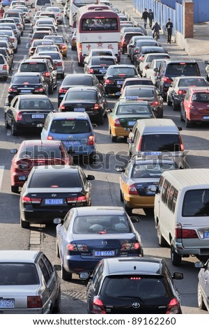 BEIJING - NOV. 19. Traffic jam in Beijing Central Business District. Recently the number of cars in Beijing hit 4 million and its car fleet grows at 1,900 cars daily. Beijing, Nov. 19, 2011.