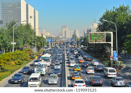 BEIJING - NOV 2: Traffic jam in Beijing's Central Business District on November 2, 2012 in Beijing, China. Beijing is expected to pass the six million vehicles on its roads by the end of the year. - stock photo