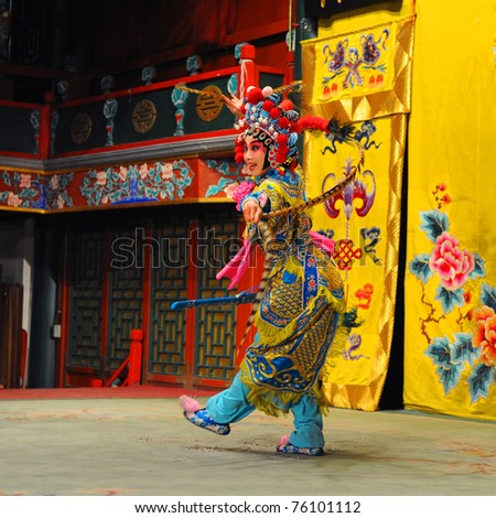 """BEIJING - NOVEMBER 16: A Beijing Opera Troupe actress performs the famous story """"Journey to the West"""" at the Huguang Theatre on November 16, 2010, in Beijing, China. - stock photo"""