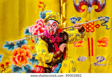 "BEIJING - NOVEMBER 16: Actor of the Beijing Opera Troupe performs the famous story ""Journey to the West"" at the Huguang Theater on November 16, 2010, in Beijing, China. - stock photo"