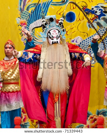 """BEIJING - NOVEMBER 16: Actors of the Beijing Opera Troupe perform the famous story """"Journey to the West"""" at the Huguang Theatre on November 16, 2010, in Beijing, China. - stock photo"""