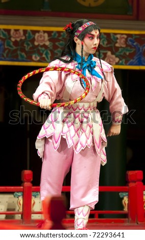 """BEIJING - NOVEMBER 16: Actress of the Beijing Opera Troupe performs the famous story """"Journey to the West"""" at the Huguang Theater on November 16, 2010 in Beijing, China. - stock photo"""