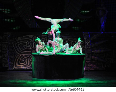 BEIJING - NOVEMBER 17: Artists of Beijing Acrobatics Troupe perform at the famous Chaoyang Theatre on November 17, 2010, in Beijing, China.