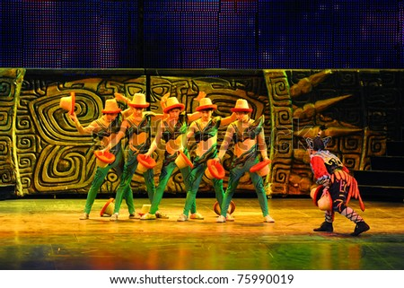 BEIJING - NOVEMBER 17: Artists of Beijing Acrobatics Troupe perform at the famous Chaoyang Theatre on November 17, 2010, in Beijing, China. - stock photo