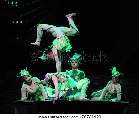 BEIJING - NOVEMBER 17: Beijing Acrobatics Troupe artists perform at the famous Chaoyang Theatre on November 17, 2010, in Beijing, China.