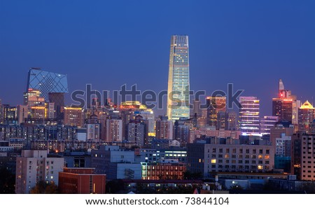BEIJING-NOVEMBER 13: Beijing's Central Business District skyline after sunset on Nov. 13, 2010 in Beijing, China. Beijing is the Capital of China, the second-largest economy in the World. - stock photo