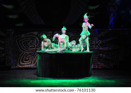 BEIJING - NOVEMBER 17: Members of the Beijing Acrobatics Troupe perform at the famous Chaoyang Theatre on November 17, 2010, in Beijing, China.