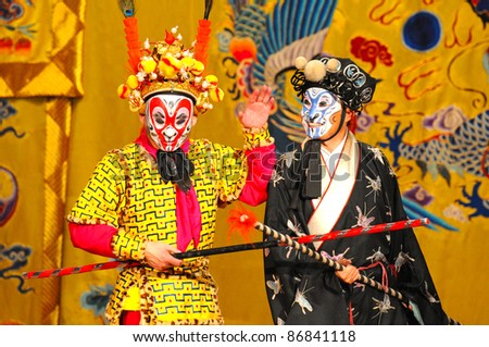 """BEIJING - NOVEMBER 16: Unidentified actors of the Beijing Opera Troupe perform the famous story """"Journey to the West"""" at the Huguang Theater on November 16, 2010, in Beijing, China. - stock photo"""